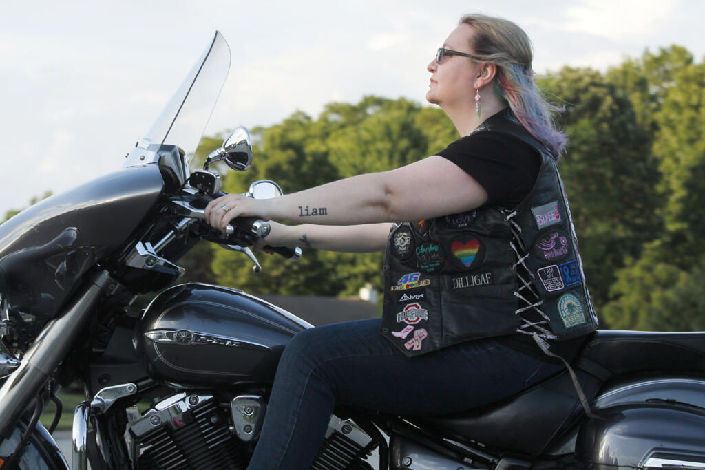 Woman pursuing her dreams, riding a motorcycle
