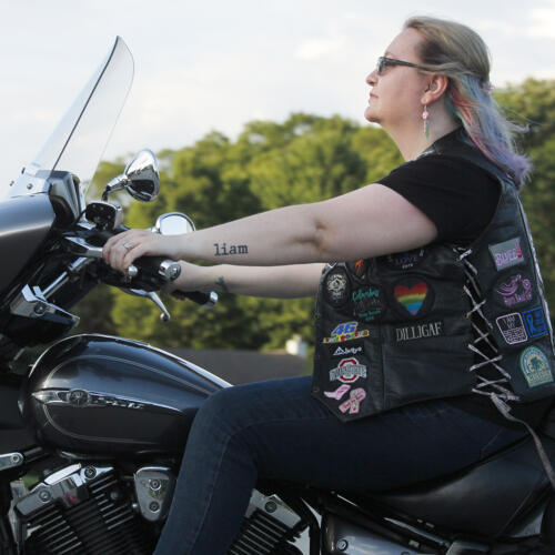 Woman riding her Harley Davidson Motorcycle