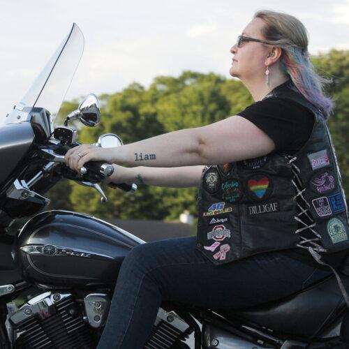 Woman riding her Harley Davidson Motorcycle